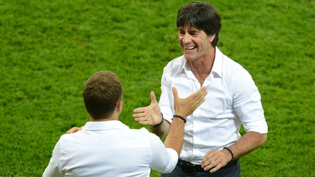 Joachim Low celebrates with his assistant Hans-Dieter Flick.