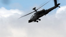 A British Army Apache helicopter displays.