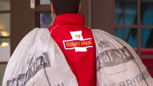 A Royal Mail postman.