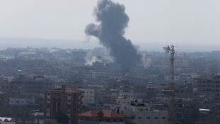 Smoke and flames are seen following what Palestinian witnesses said was an Israeli airstrike in the southern Gaza strip.