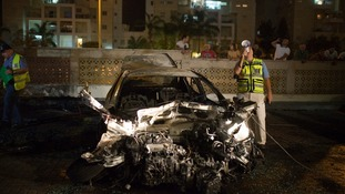 A damaged car after it was hit by a rocket believed to have been fired from Gaza.