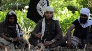 Abdul Raqib Amin (R) in an Isis recruitment video with other British jihadists.