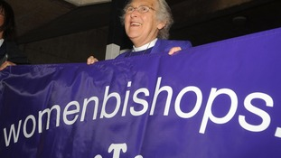 Jean Mayland from Women And The Church with a banner for women bishops.