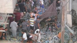 People search through the rubble of the homes.