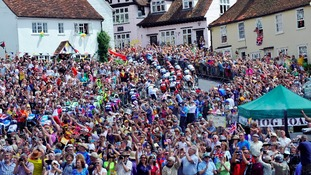 Riders make their way up the short climb in the village of Finchingfield during the Tour de France.