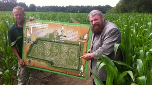 Brian Blessed with a plan of the maze