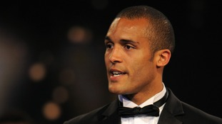 Clarke Carlisle said he would want to walk off the pitch if he received a torrent of racial abuse.
