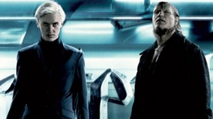 Dave Legeno (R) as werewolf Fenrir Greyback with Tom Felton, who played Draco Malfoy.