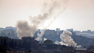 Smoke rages as rocket attacks between Israelis and Palestinians continue.