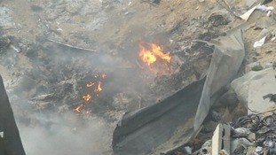 Fire was still burning in the rubble of the building hours after the attack.