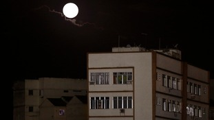 A moon is seen over the neighbourhood of Vasco da Gama in Brazil.