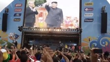 Faked pictures show Kim Jong-Un cheered by football fans.