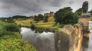 Alnwick Castle and moat plus moody overcast sky