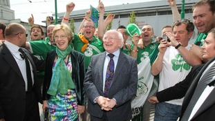 President Michael D Higgins and his wife Sabina meet football fans from Andersonstown in West Belfast.