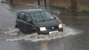 Beccles Road in Gorleston, Norfolk flooded by torrential rain.