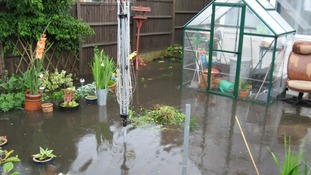 Gardens flooded by the torrential rain.