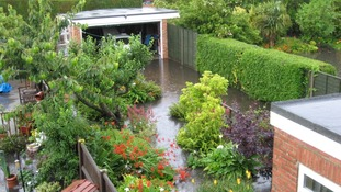 Gardens flooded after the torrential downpour in Gorleston, Norfolk.