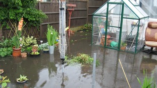 Flooded garden in Gorleston, Norfolk after the downpours on Sunday 13 July