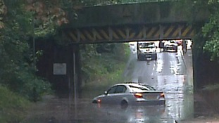 A car trapped in flooding below a railway bridge near Brundall, Norfolk.