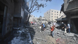 Palestinians extinguish a fire which police said was caused by an Israeli air strike in Rafah in the southern Gaza Strip.