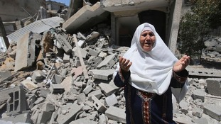 A Palestinian woman in front of the remains of her house, which was destroyed in an Israeli air strike, in Rafah in the southern Gaza Strip.