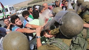 Israeli soldiers scuffle with a Palestinian protester during a protest against the Israeli air strikes in Gaza strip.