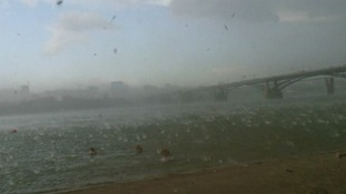 The debris flying on the beach in Novosibirsk, Siberia, when a sudden storm sent sunbathers running.