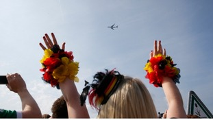 Fans in the capital cheered as the players' flight arrived overhead.