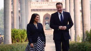 Witham MP Priti Patel with the Prime Minister in India in 2013.