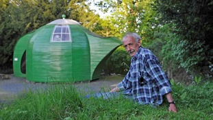 Ian Hunter with his teapot shed