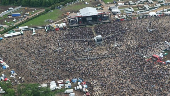 Fans gather at Download festival ahead of Black Sabbath performance at 22.45 BST