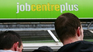Men outside a Job Centre Plus branch