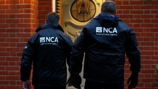 NCA officers attend an address on a previous operation.