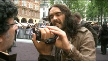 Russell Brand grabs a camera
