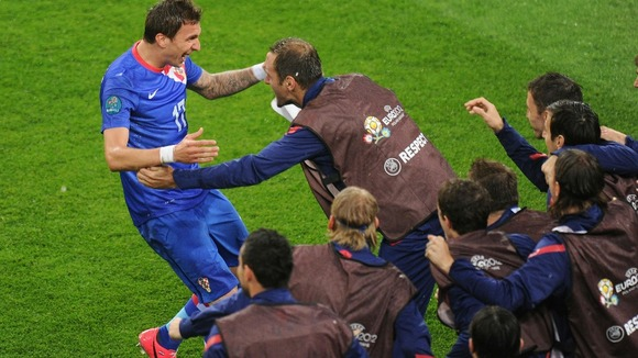 Mario Mandzukic celebrates his first goal against Ireland.