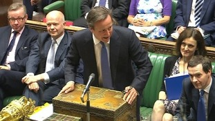 David Cameron makes a joke as George Osborne eyeballs the opposition.