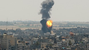 Smoke and flames are seen following what witnesses said was an Israeli air strike in Gaza City