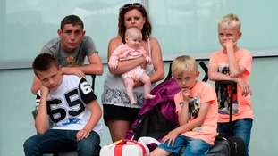 The fed up families had to camp out at Birmingham Airport for more than 10 hours after missing their original flight from East Midlands Airport.