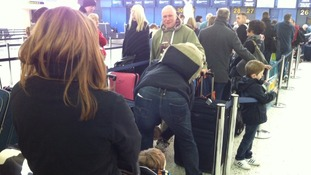 Library photo of queues at East Midlands Airport