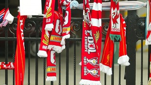 Scarves and flowers outside the gates of Anfield on 17th Anniversary of the Hillsborough disaster