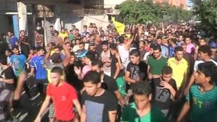 Hundreds gather to mourn the 4 boys, killed earlier today by naval gunfire.
