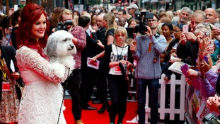Ashleigh Butler and Pudsey pose for photographs at the premiere of their new film in London.