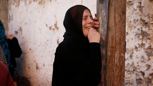 A woman grieves during the funeral of the four Palestinian children