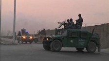 Afghan security personnel are seen on vehicles as an area near the Kabul airport.