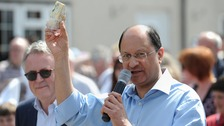 North West Cambridgeshire MP Shailesh Vara holds up a piece of Stilton cheese