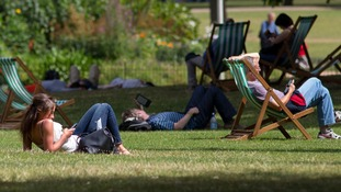 People enjoy the sunshine in St James's Park