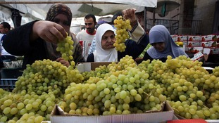 Palestinians shop for food during the humanitarian ceasefire in Gaza.