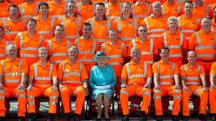 The Queen poses for a team photograph