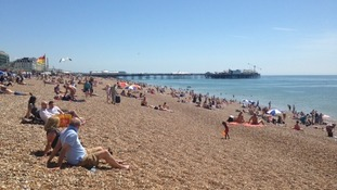 People enjoying a day out on Brighton Beach