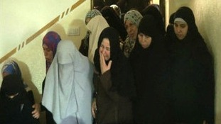 Women mourn as funeral held for four Palestinian children killed